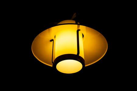 Photo pour Indoor night lamp isolated against pure black, warm glow - image libre de droit