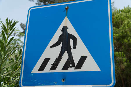 Sign on the road - Man crossing