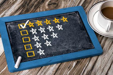 five star rating concept on blackboard