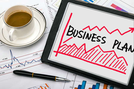 Photo for business plan with financial chart hand-drawn on tablet pc - Royalty Free Image