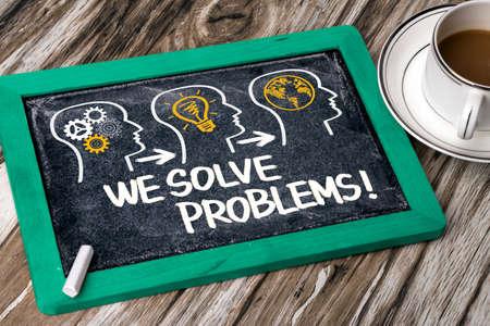 we solve problems concept on blackboard