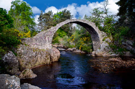 Ancient curved Carr Bridge in Scotland