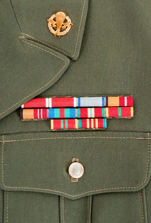 Military awards and decorations on green uniform