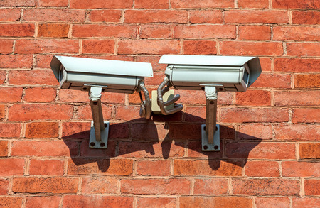 Surveillance cameras mounted on the wall of the building