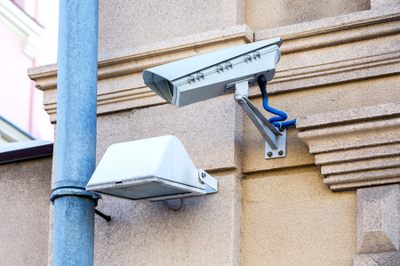 Surveillance camera mounted on the wall of the building