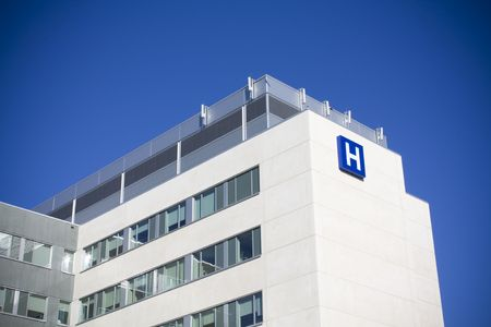 Modern hospital against deep blue sky shot in summer