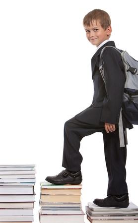 Photo pour Education success graph - successful schoolboy isolated on white background - image libre de droit