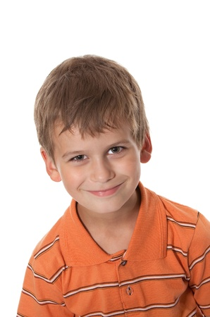 Photo pour Cute boy smilling isolated on a white background - image libre de droit