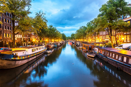 Photo pour Canals of Amsterdam at night. Amsterdam is the capital and most populous city of the Netherlands - image libre de droit