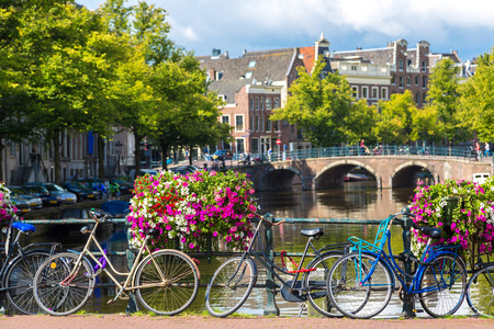 Bicycles on a bridge over the canals of Amsterdam. Amsterdam is the capital and most populous city of the Netherlands