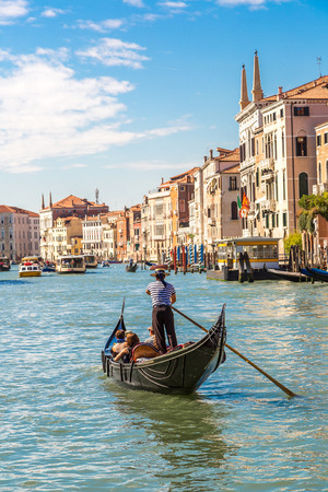 Gondola on Canal Grande in Venice, in a beautiful summer day in Italy