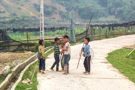 SAPA, VIETNAM - JUNE 19, 2018: Ethnic minority children in Sapa, Lao Cai, Vietnam in a summer day
