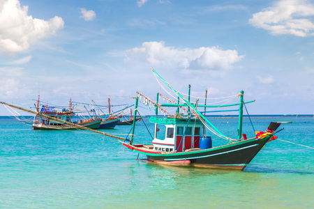 Photo pour Traditional wooden fisherman boat on Koh Phangan island, Thailand in a summer day - image libre de droit