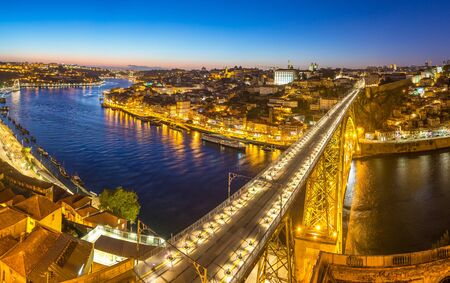 Photo for Panoramic aerial view of Dom Luis Bridge in Porto in a beautiful summer night, Portugal - Royalty Free Image