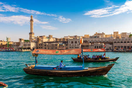 Foto für DUBAI, UAE - APRIL 5, 2020: Abra - old traditional wooden boat on the bay Creek in Dubai, United Arab Emirates - Lizenzfreies Bild