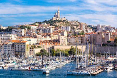 Photo pour MARSEILLE, FRANCE - JULY 12, 2014: Aerial panoramic view on basilica of Notre Dame de la Garde and old port  in Marseille, France - image libre de droit