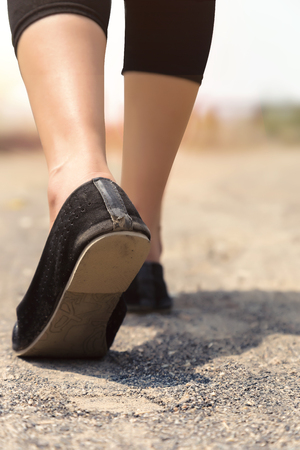 Woman with legging and Ethnic Footwear.