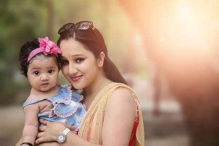 Foto de Close-up Of A Mother Loving Her Baby girl - Imagen libre de derechos