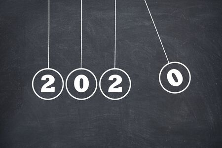 Photo pour New Year 2020 Newtons Cradle on Chalkboard, new year concept - image libre de droit