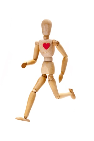 A image of a wooden mannequin running as a concept for healthy living