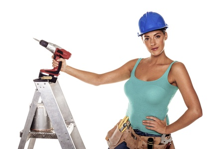 Photo pour A woman wearing a DIY tool belt full of a variety of useful tools on a white background  - image libre de droit