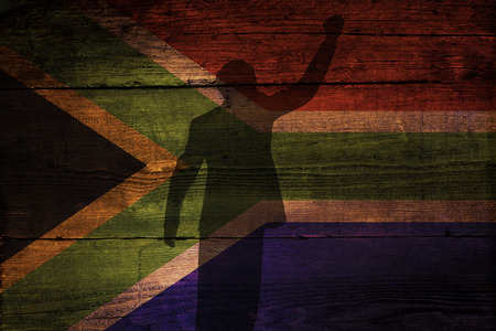 An South African flag on a grunge wooden background with a shadow overly for freedom