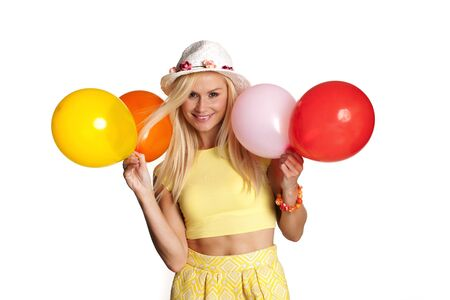 Beautiful woman holding balloons over a white background.