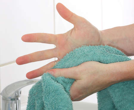 Drying hands using a towel