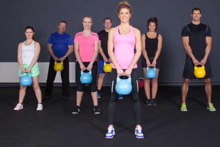 crossfit  group of people with kettlebells