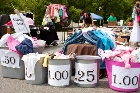Lilburn, GA, USA - April 21:  Shoppers look over merchandise on sale for dirt cheap prices at the Lilburn citywide garage sale, held in the city hall parking lot.