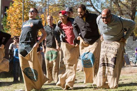 Photo pour Atlanta, GA, USA - November 14, 2015:  Men compete in an old-fashioned sack race at the King of Pops Festival in Atlanta, GA on November 14, 2015. - image libre de droit