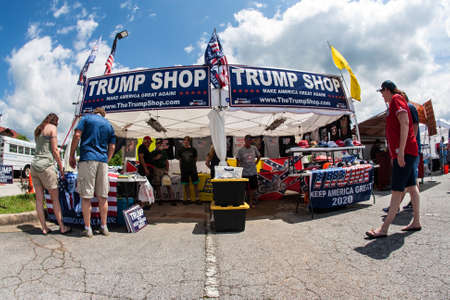 Helen, GA, USA - June 2, 2018:  Couples shop for merchandise at the Trump Shop, a popup outdoor store selling Donald Trump apparel and other items in a parking lot on June 2, 2018 in Helen, GA.