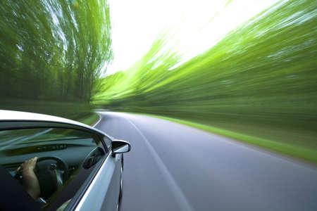 Foto de car driving fast into forest - Imagen libre de derechos
