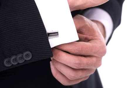 Close up of businessman wearing cufflinks. Isolated on white