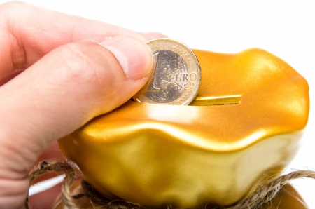 A coin is deposited through a slit to save money