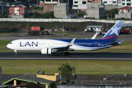 Quito, Ecuador - June 16, 2011: A LAN Boeing 767 jet airliner with the registration HC-CJX taxis on Quito International Airport (UIO) in Ecuador. LAN Airlines is the flag carrier of Chile based at Santiago Airport. It operates with 117 jet airliners and c