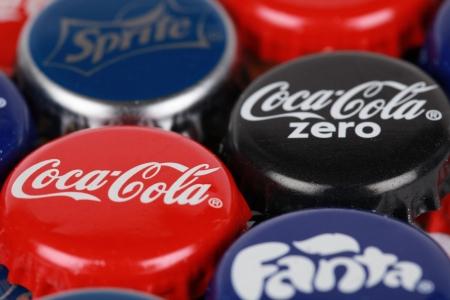 Stuttgart, Germany - October 6, 2012: Group of Coca-Cola, Coca-Cola Zero, Fanta and Sprite bottle caps. Macro shot with shallow depth of field.