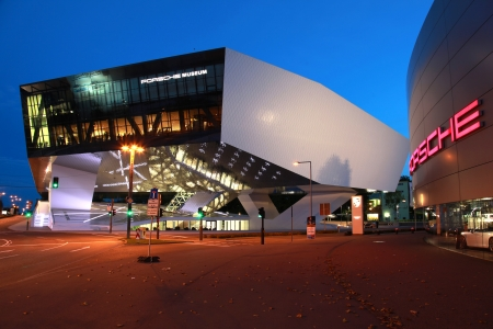Stuttgart, Germany - October 3, 2012: Porsche Museum and a Porsche dealer in Stuttgart Zuffenhausen. Porsche is a German company with investments in the luxury automotive industry.