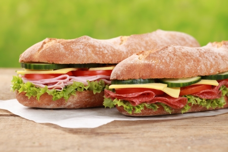 Baguettes with salami, ham, cheese, tomatoes, lettuce and cucumber