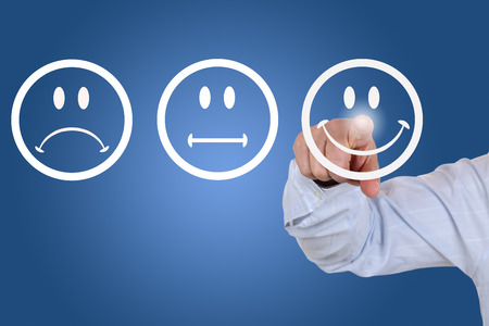 Businessman gives a positive vote for service quality with a smiley