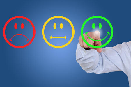 Photo pour Businessman gives a positive vote for service quality with a green smiley - image libre de droit