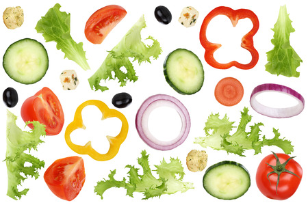 Ingredients for flying salad with tomatoes, Feta cheese, lettuce, onion, olives and cucumber