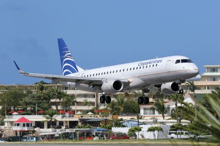 St. Martin, Netherlands Antilles - February 8, 2014: A Copa Airlines Embraer ERJ190 with the registration HP-1557CMP approaching St. Martin Airport (SXM). St. Martin is rated one of the most dangerous airports in the world. Copa Airlines is the flag carri