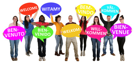 Refugees welcome in different languages group of young multi ethnic people isolated