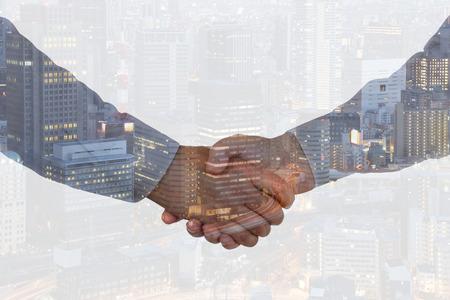 Photo pour Handshake business hand shake shaking hands deal success welcome city double exposure partnership - image libre de droit