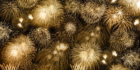 Foto de New Year's Eve fireworks gold golden background banner years year firework backgrounds - Imagen libre de derechos