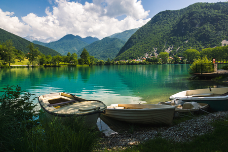 Boats by the Soca river in Most na Soci, Slovenia