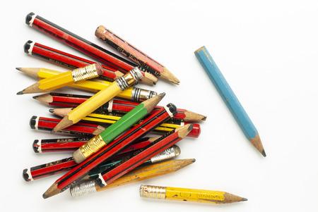 Photo pour Old,used wooden graphite pencils on white paper - image libre de droit