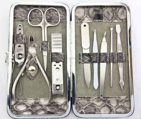 A set of metallic manicure tools.