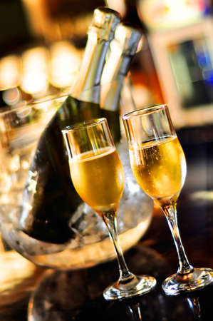Isolated glasses of champagne and bottles, saturated